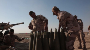 Iraqi soldiers fire artillery rounds