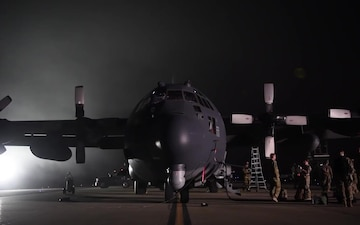 AC-130 parked at night
