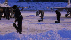 Airmen Keep F-16sFlying Despite Snowy Conditions