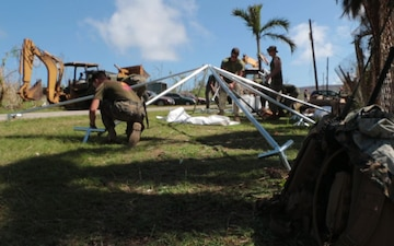 CLB-31 Marines assemble a FEMA emergency shelter on Tinian
