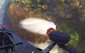 Cal Guard UH-60M Black Hawk drops water on Camp Fire