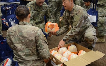 Unit ministry teams distribute food before Thanksgiving holiday