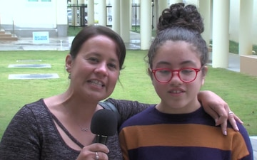 USAF Sgt. Maria Ferrer and daughter give a holiday shout out from Kadena Middle School.