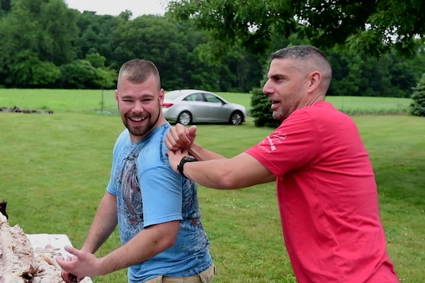Soldiers embrace brotherhood of arms years after surviving attack