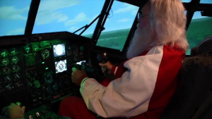 Santa trades sleigh for C-130 at this year's Santa Lift