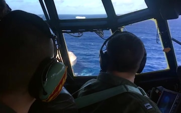 A Coast Guard HC-130 Hercules aircrew flies over the 650-foot Sincerity Ace