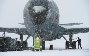 A KC-135 Stratotanker crew chief prepares his aircraft