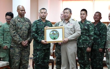A Thailand Governor meets with U.S. and other military officials
