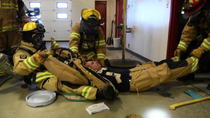 Firefighters conduct rapid intervention training