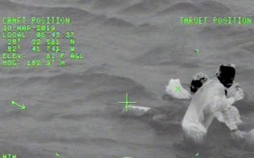 Coast Guard rescues 3 adults, 12-year-old boy after boat sinks