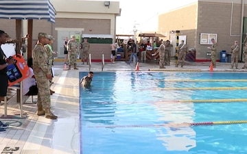 Go for Gold: Service Members Swim at GAFB to Advance
