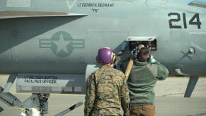 U.S. Airmen and Marines Work Together to Fuel F-18E's and a C-130J