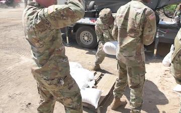 Arkansas National Guard Soldiers Help Fill Sandbags in Dardanelle, Arkansas