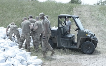 Illinois National Guard Soldiers work along the Heartwell Levee