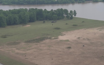 Arkansas National Guard Airlifts Hay Bales to Stranded Cattle