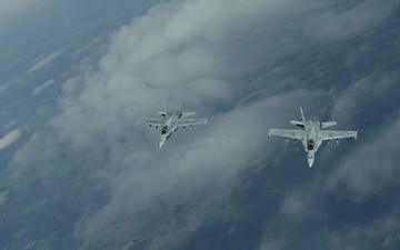 U.S. Air Force F-35A & Finnish F-18s fly together