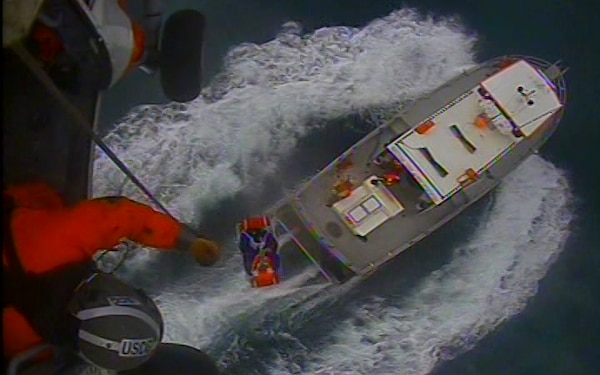 The Coast Guard medevacs a man who lost consciousness aboard a charter fishing vessel near Seward, Tuesday, June 18, 2019. An MH-60 Jayhawk helicopter crew from Aviation Support Facility Cordova hoisted the 61-year-old man, who was experiencing symptoms of a heart attack just off Cape Resurrection. U.S. Coast Guard video courtesy of Air Station Kodiak