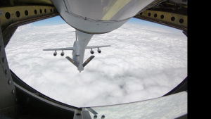 KC-135 Performs Aerial Refuel With C-5