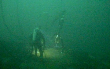 Deep-Water Diver Fits a Pumping System to Recover Oil from the Coimbra Shipwreck