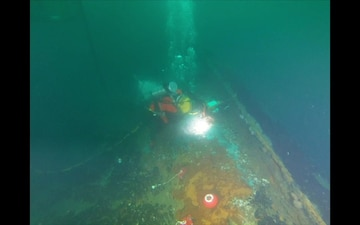 Coimbra Response Diver Installs Secured Valve Caps at a Depth of 180 Feet