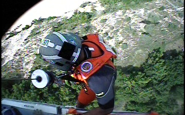 VIDEO RELEASE, UPDATE: Coast Guard rescues woman, dog from bottom of cliff near Ludington, Mich.