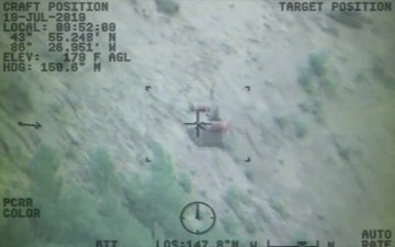 Coast Guard rescues woman, dog from bottom of cliff near Ludington, Mich.