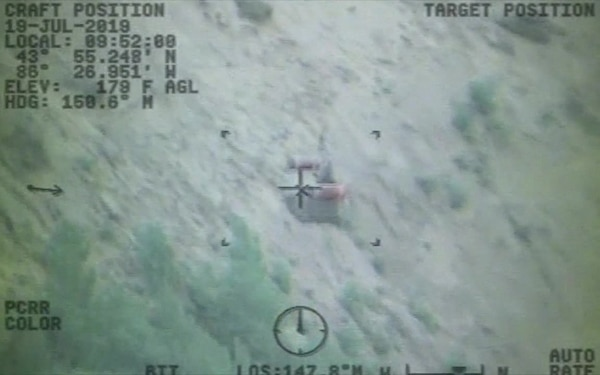UPDATE 2; VIDEO RELEASE: Coast Guard rescues woman, dog from bottom of cliff near Ludington, Mich.