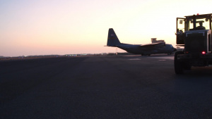 C-130 Night Ops Cargo and Passenger Loading B-roll