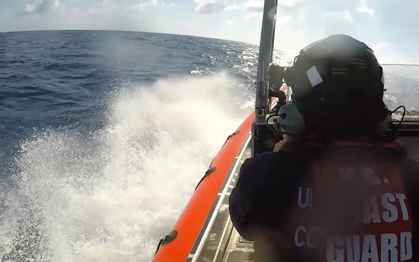 A U. S. Coast Guard boarding team in an interceptor boat deployed from the Coast Guard Cutter Robert Ward (WPC-1130) approaches a suspected drug smuggling vessel in international waters of the Eastern Pacific Ocean July 16, 2019, during a patrol of drug transit zones in the region. An estimated 3,000 pounds of cocaine were discovered aboard the vessel and three suspected smugglers were detained. (U.S. Coast Guard video)