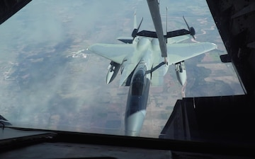 Travis KC-10 Extender refuels 57AW F-15C Eagles