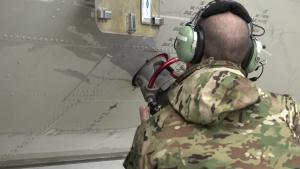 U.S. Airmen refueling E-8C JSTARS