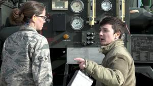 U.S. Airmen refuel an E-8C Joint STARS