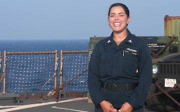 GM3 Domingos aboard the USS Germantown (LSD 42) sends Thanksgiving message home while deployed in the 7th Fleet AOR