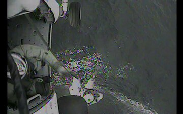 Rescue crew from Air Station hoists fisherman in life raft