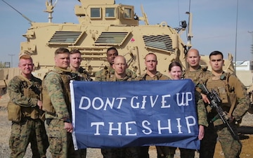 U.S. Marines show support for the Navy Midshipmen team from Afghanistan