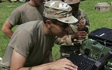 Signal Soldier Types on Keyboard during Communications Exercise