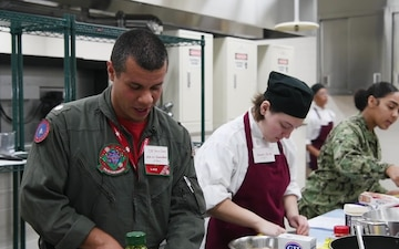 VFA-102 Sailors, MC Perry High School students team up to cook