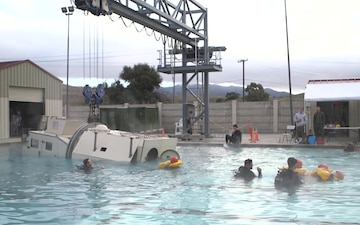 B-ROLL - Assault Amphibian School students take a ride in the Submerged Vehicle Egress Trainer