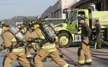 B-Roll: Aircraft Rescue and Firefighting conducts handline drills