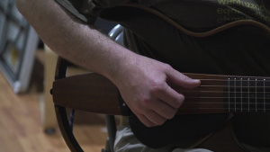 103rd ESC Soldier Volunteers at American Red Cross as a Guitar Instructor