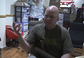 103rd ESC Soldier Volunteers at American Red Cross as a Guitar Instructor -Clean-