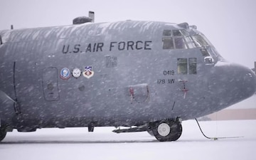 C-130 Snowfall on Flight Line (B-roll)