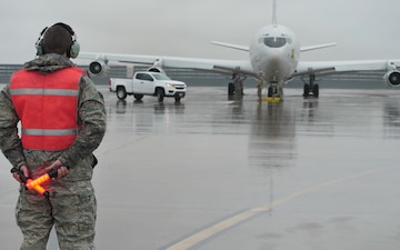 B-Roll - E-8C Joint STARS maintainers and flight crew Airmen brave rain to meet mission readiness