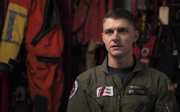 Coast Guard rescue swimmer rescues 2 people from cargo vessel