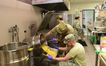 178th Force Support Squadron members prepare for drill weekend meal