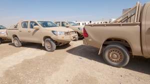 Coalition Forces transfer arms, equipment, vehicles to Iraqi forces