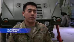 NATO BG-P Soldiers perform maintenance on a HMMWV