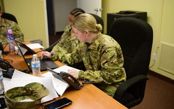 Arkansas National Guard Soldiers answer phone calls about Covid-19
