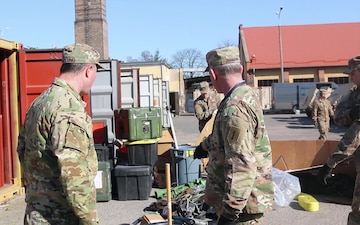 1ID Fwd Soldiers conduct container maintenance in Poland