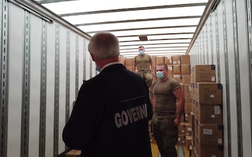 Arkansas National Guardsmen unload trailers of PPE for the state